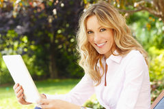 Mature woman portrait with digital tablet Royalty Free Stock Photo