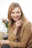 Mature woman portrait. Waist up portrait of mature caucasian woman in her 40's stock image