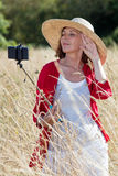 Mature woman posing for countryside selfy and vacation memories Stock Photos