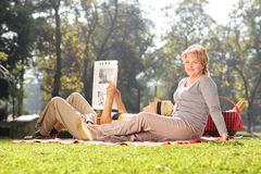 Mature woman posing in park with her husband royalty free stock image