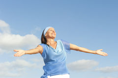 Mature woman positive open arms outdoor Royalty Free Stock Images