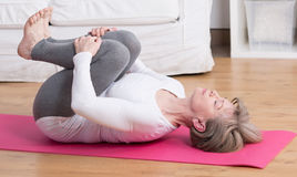 Mature woman practicing pilates Stock Photo
