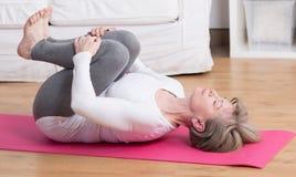 Mature woman practicing pilates stock photo