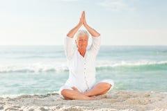 Mature woman practicing yoga Stock Photo
