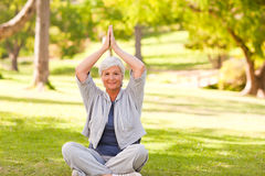Mature woman practicing yoga Royalty Free Stock Images