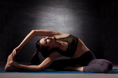 Mature woman practicing yoga Stock Photos