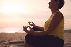 Mature woman practicing yoga Stock Photos