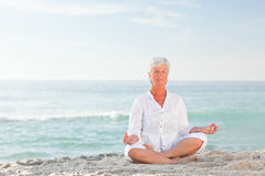 Mature woman practising yoga Royalty Free Stock Photography