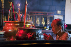 Mature Woman Praying with Incense Stick Royalty Free Stock Images