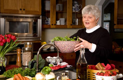 Mature woman preparing greens. Stock Image