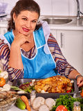 Mature woman preparing at kitchen Royalty Free Stock Photos