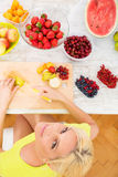 Mature woman preparing a smoothie Stock Photo