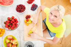 Mature woman preparing a smoothie Stock Photos