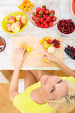 Mature woman preparing a smoothie Stock Image