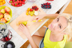 Mature woman preparing a smoothie Royalty Free Stock Image