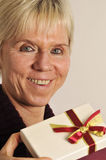 Mature woman with present Royalty Free Stock Photo