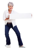 Mature woman presenting banner Stock Images