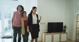 Mature woman professional real estate agent make a house tour shows the all interior modern design for a young family