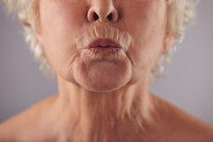 Mature woman puckering lips Stock Photos