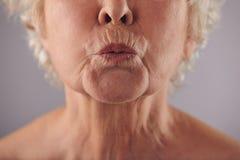 Mature woman puckering lips stock photos