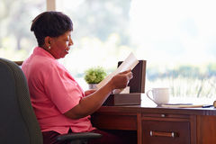 Mature Woman Putting Letter Into Keepsake Box Royalty Free Stock Images