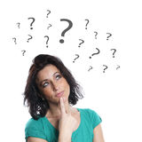 Mature woman with question marks Royalty Free Stock Photography