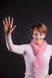 Mature woman with a raised hand Stock Photos