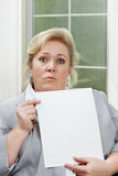 Mature woman reacts with surpise Royalty Free Stock Photo