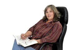 Mature woman reading Royalty Free Stock Image