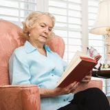 Mature woman reading. stock image