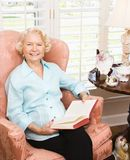 Mature woman reading. Royalty Free Stock Photography