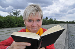 Mature woman reading book Stock Photos
