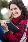 Mature woman reading a book Royalty Free Stock Images