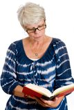 Mature woman reading a book Stock Photography