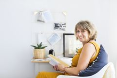 Mature woman reading book stock photography