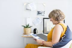 Mature woman reading book royalty free stock photo