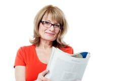 Mature woman reading book Stock Image