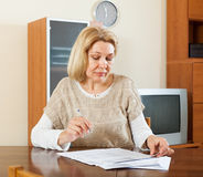 Mature woman reading document Stock Photo
