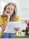 Mature Woman Reading Documents Royalty Free Stock Image