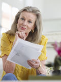 Mature Woman Reading Documents Royalty Free Stock Photo