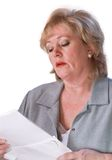 Mature woman reading mail Royalty Free Stock Photos