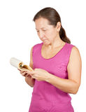 Mature woman reads notebook Royalty Free Stock Photo