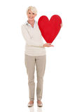 Mature woman red heart Stock Images
