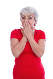 Mature woman in a red shirt shocked and isolated on white. Stock Photos