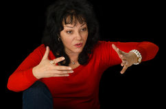 Mature woman in red sweater arguing Stock Photos