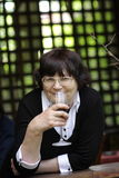 Mature woman with red wine Royalty Free Stock Image