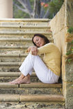 Mature woman relaxed closed eyes outdoor Stock Photo