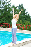 Mature woman relaxed in front of the pool Stock Photo