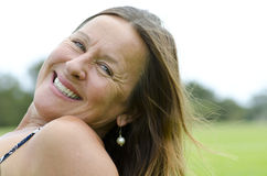 Mature Woman relaxed on grass Stock Photo