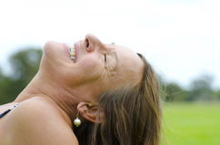 Mature Woman relaxed on grass Stock Photos
